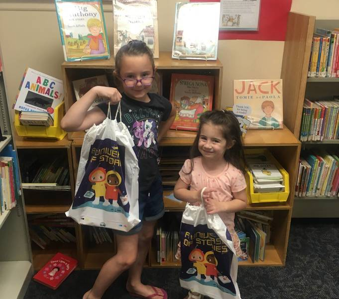 Keira and Grace O'Toole picking up their goody bags.