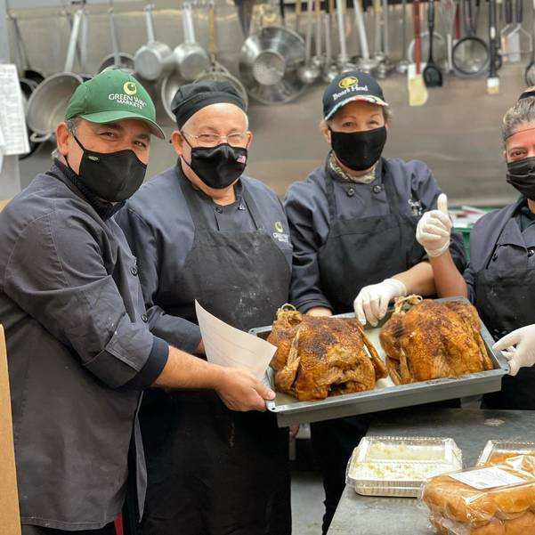 Green Way Market of Cross River Deli Catering Team prepares turkeys for delivery. Left to Right:  Arturo, Antonio, Antoinette, and Anna.
