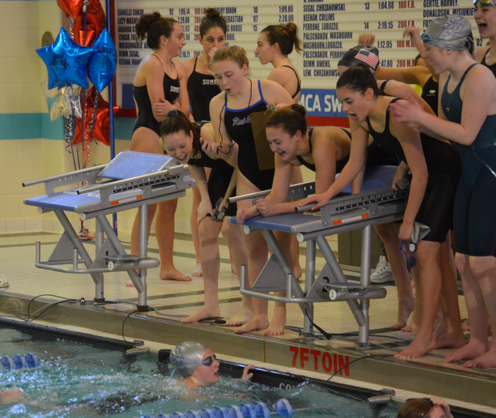 Teammates cheer on senior Nicole Kenny as she swims in her final race for Scotch Plains-Fanwood.png