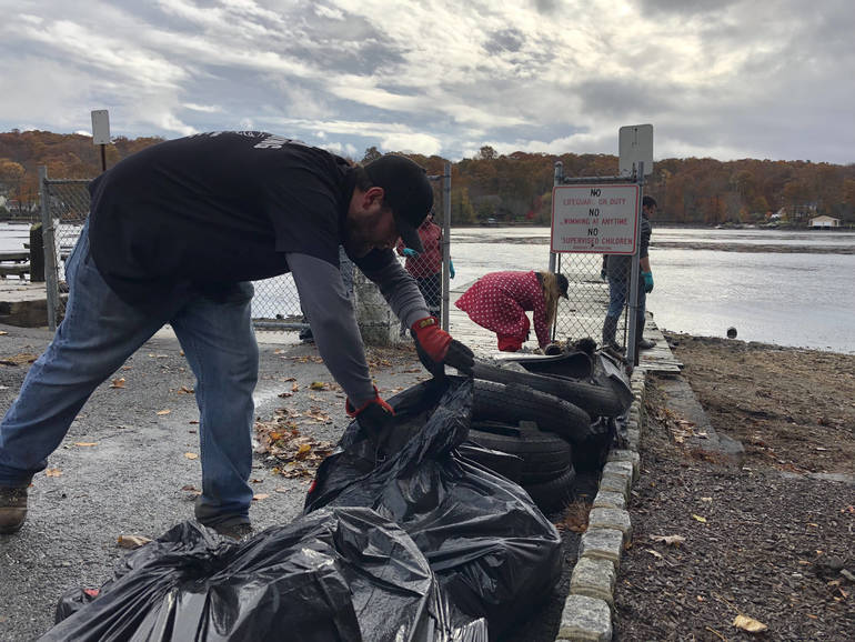 The bags and debris piled up as the morning unfolded during the lake-wide cleanup..jpg