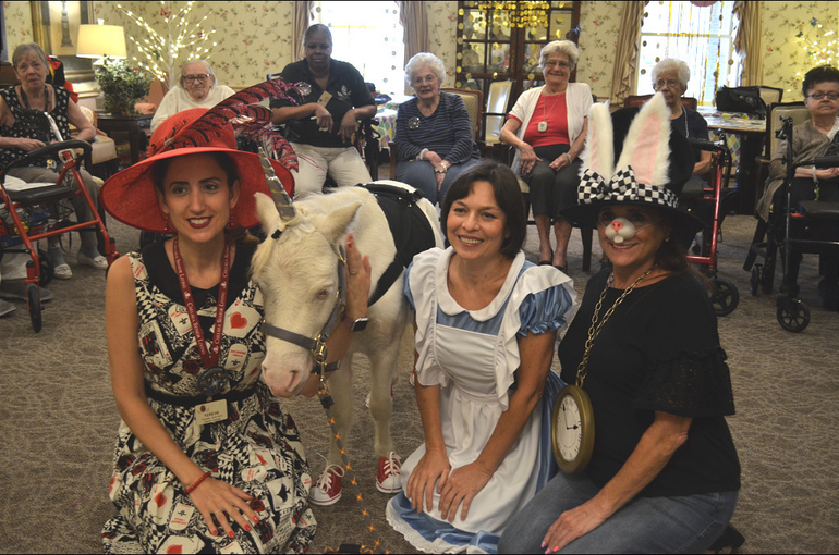 The Queen of Hearts, Alice in Wonderland, and Mad Hatter pose with Unicorn at The Chelsea at Fanwood.png