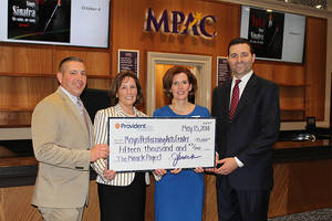 Carousel image 0a6884871c45b28a525e the provident bank foundation check presentation to mpac