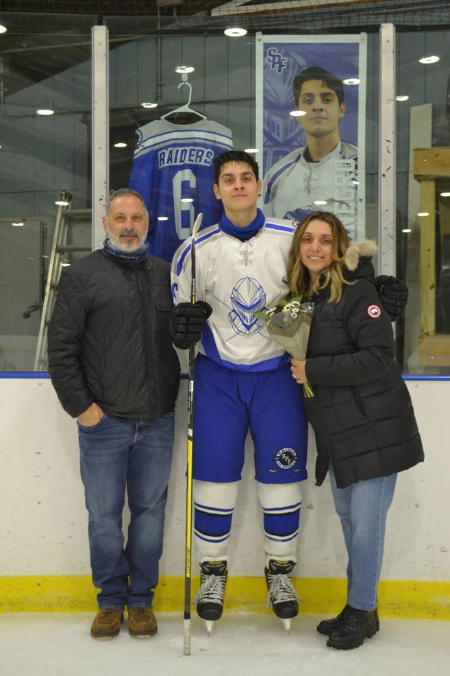 #6, Nick Tittanegro with his parents at Scotch Plains-Fanwood hockey Senior Night.