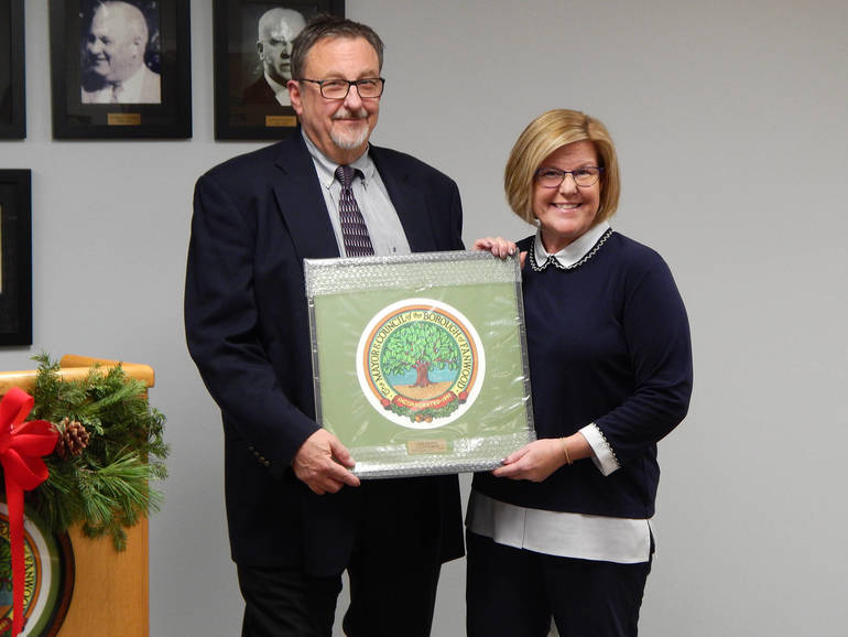 Fanwood Mayor Colleen Mahr presents the Borough Shield to outgoing Councilman Tom Kranz.