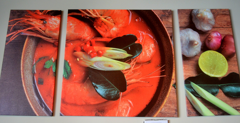 Tom Yum Soup photograph on the wall at Seating at Tasty Thai in Fanwood.