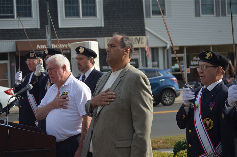 Tom Donatelli, Sal Perillo and the Knights of Columbus stand during the national anthem..png