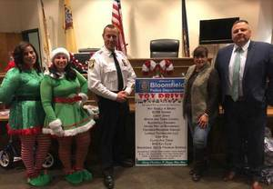 Carousel image fc6856fa03d0507af808 toy drive police 2018 a