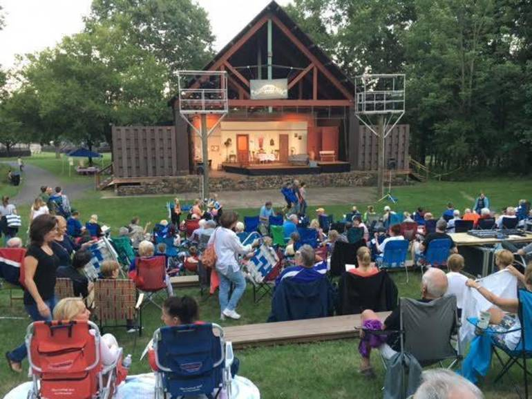 Crowd of theatergoers at Pleasant Valley Park's outdoors amphitheater