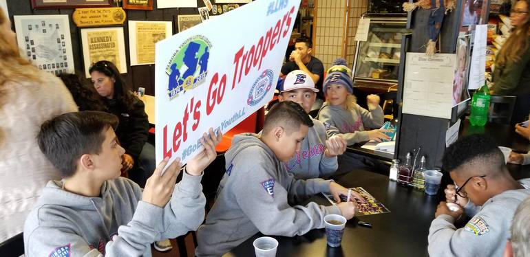Trooper Sandwich 19 - Players with Sign.jpg