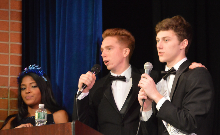 Tyler Stines and Danny Wright thank the crowd as Aloka Nannayakkara looks on.png
