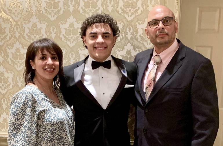 Vazquez Scholar Athlete w Parents.jpg