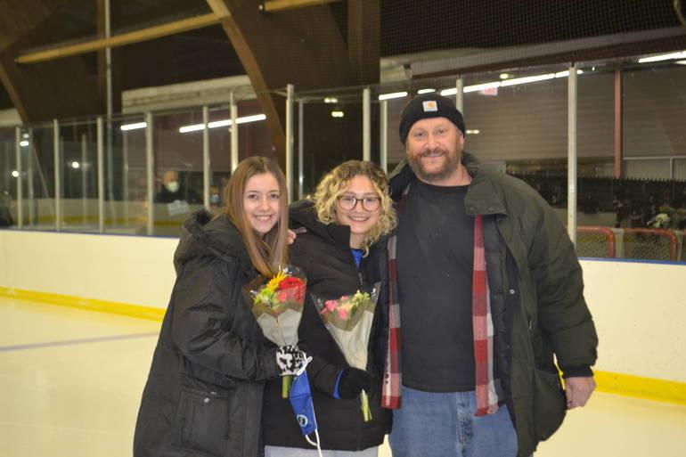 Statisticians Jade Glassman & Jamie Valian and her father at Scotch Plains-Fanwood hockey Senior Night.