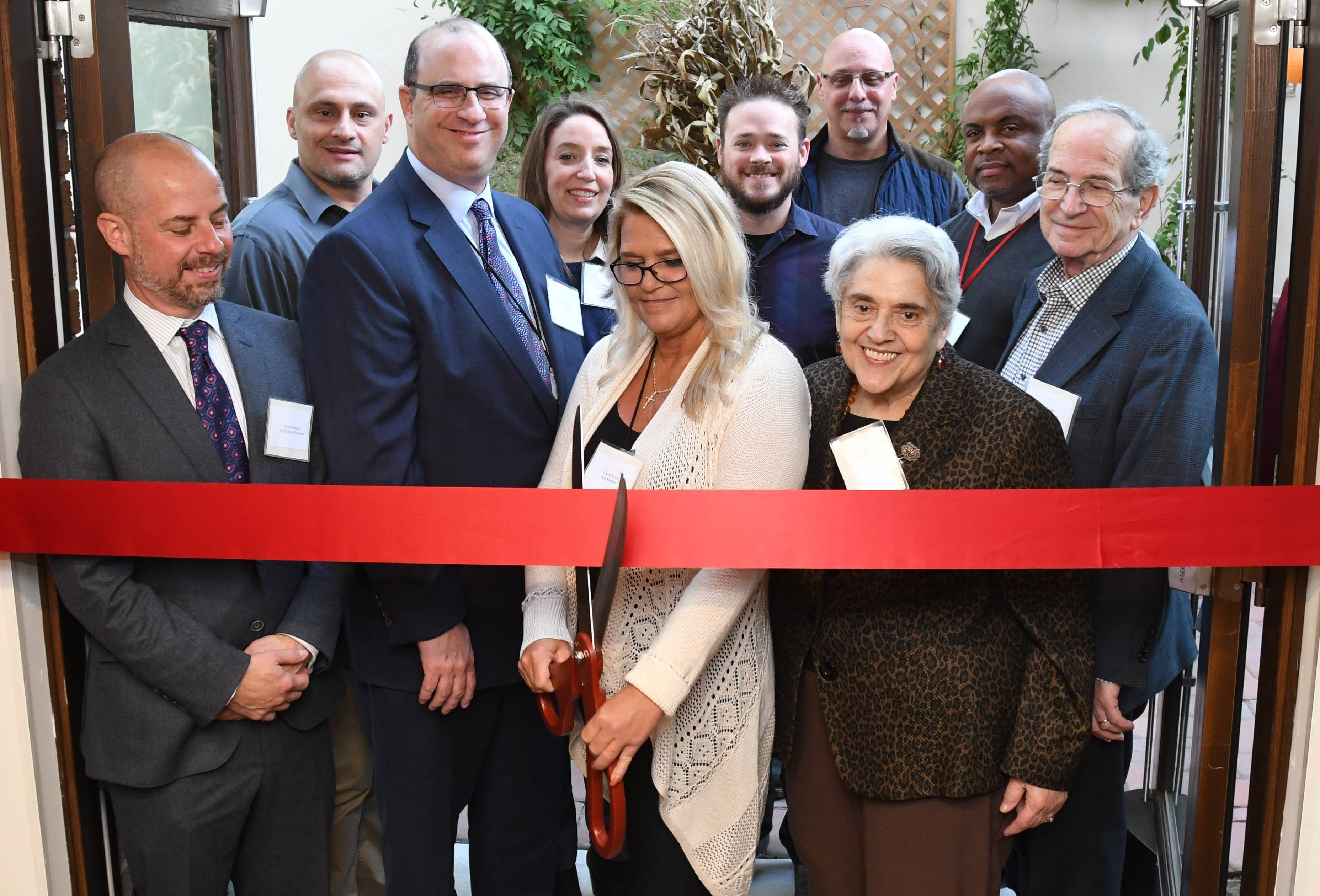 Cutting the ribbon to the new Village Apartments