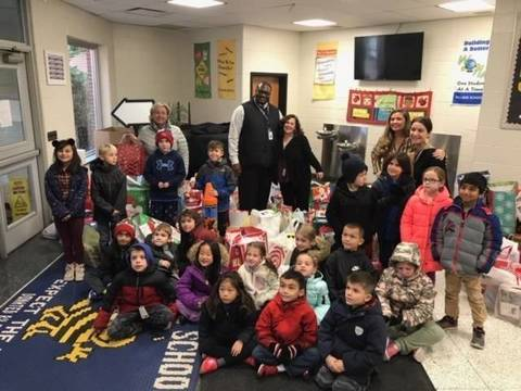 Top story dccde9111457a5c19a44 village school gives back
