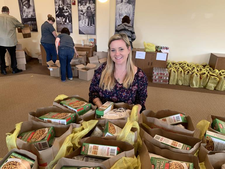 Volunteers will pack Thanksgiving dinners for hundreds of families..JPG