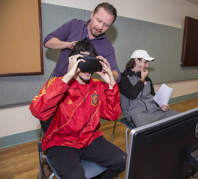 Web_Professor Brian Olson with Student in virtual-reality lab.jpg