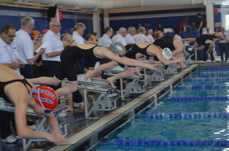 Westfield's Erin McAndrew, Scotch Plains-Fanwood's Aislinn Mooney, and Gov. Livingston's Kate Curran ready to swim in the 200 Freestyle at the NJSIAA Meet of Champions.