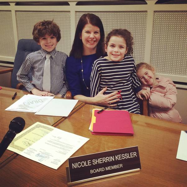 with kids at boe table.JPG