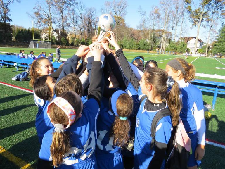 Wolves Raise Cup.JPG