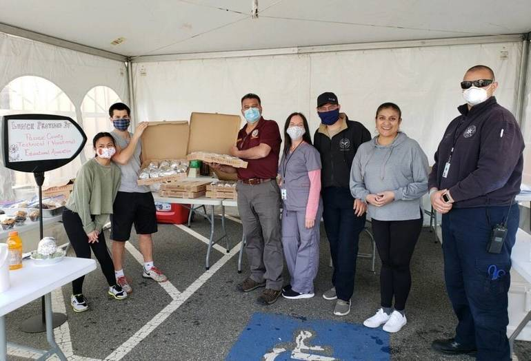 WPU testing site frontline workers with lunch donated by Passaic County Technical Voccational Education, School Office Employees, & Custodian-Maintenance Associations, 5-19-2020.jpg