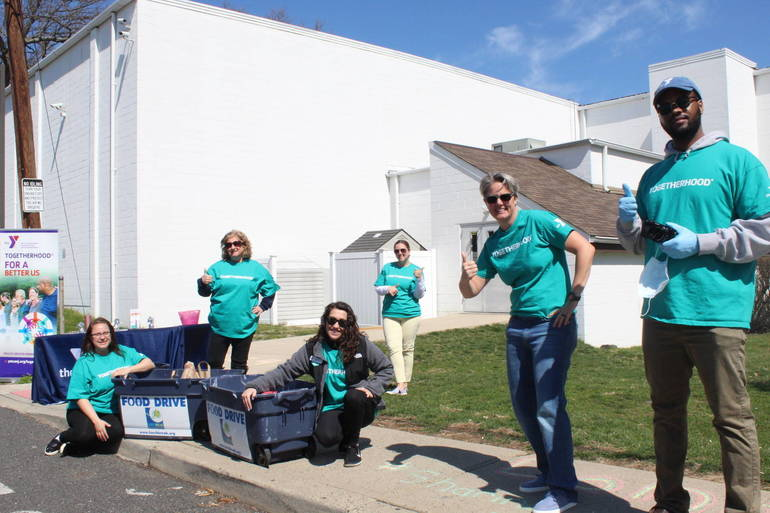 YMCA of Greater Monmouth County President & CEO Laurie Goganzer (2nd from left) helping out with the Y's Food drive.JPG