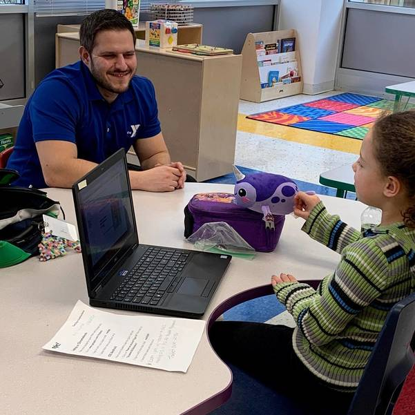 YMCA Staff Member Angelo Petullo with child at Geyer Family YMCA