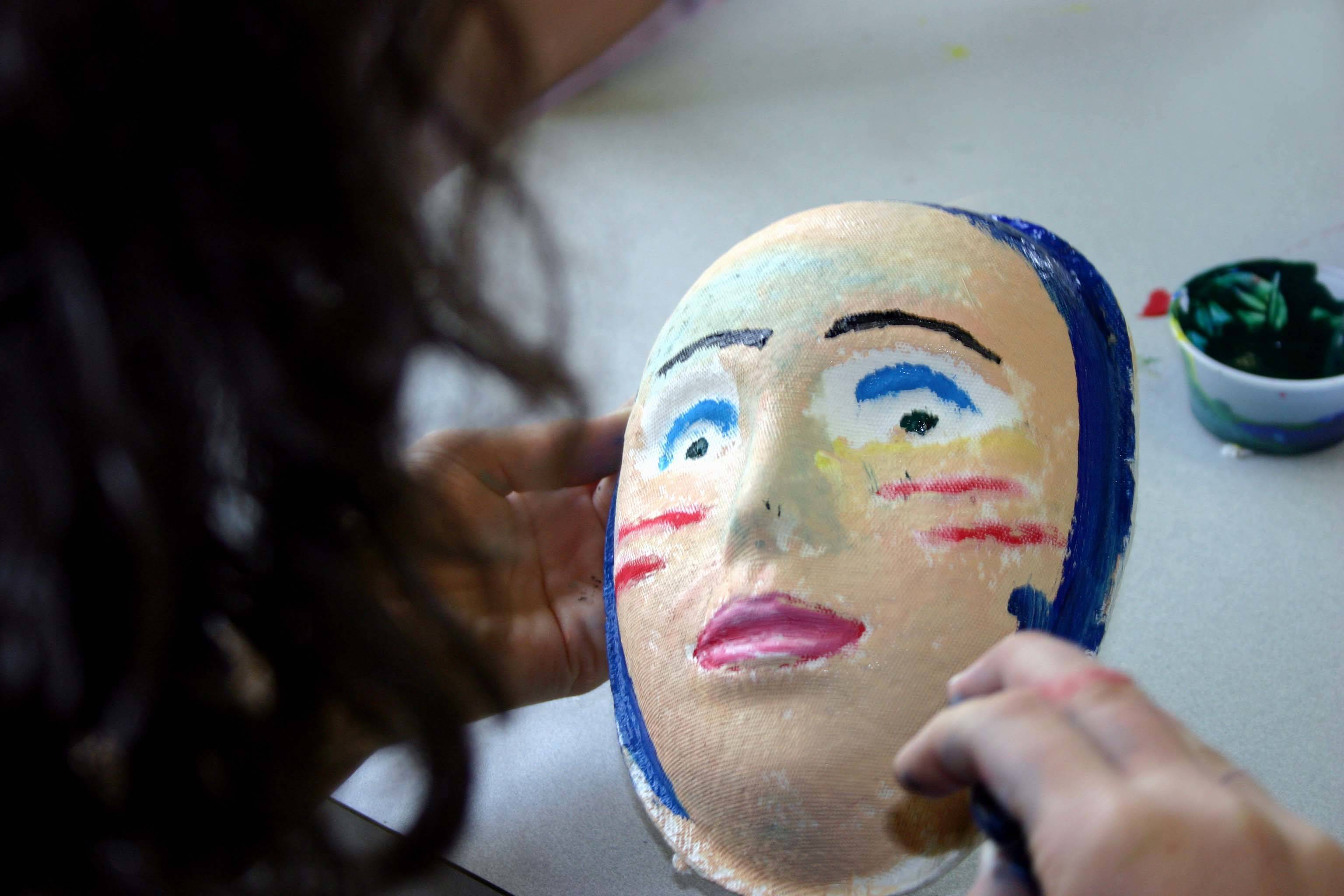 Youth art picture with mask.jpg