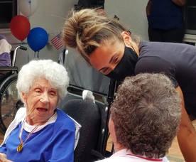 Olympic Gold Medalist Sydney McLaughlin Visits Elders At Parker At Landing Lane