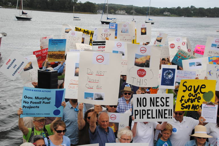 3-Citizens holding signs rally together against the NESE Pipeline with Governor Murphy's home in the background.JPG