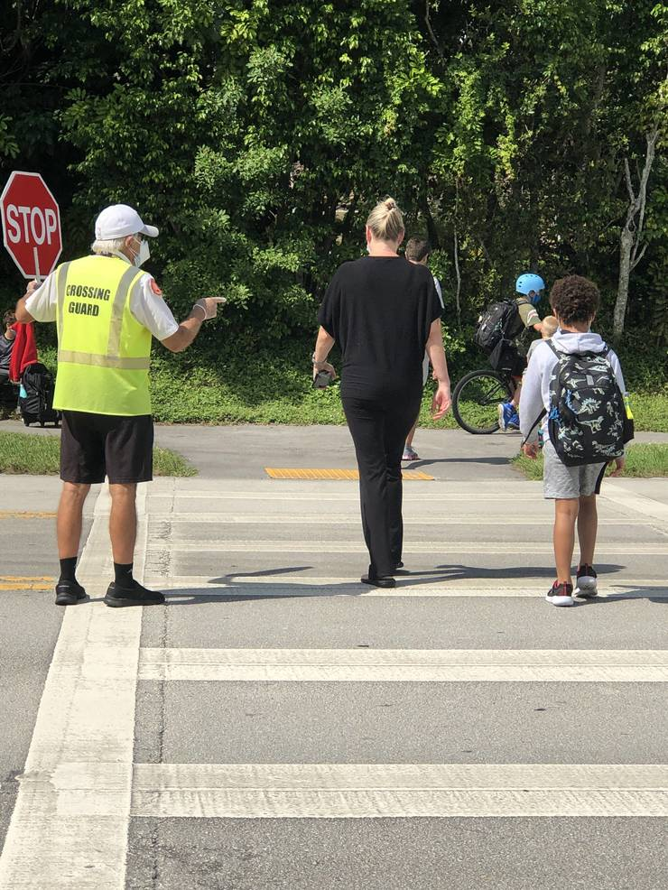"""""""Mr. Alex"""" Keeps Students and Parents Safe As They Return To School"""