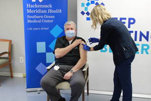 Dr. Mastrokyriakos receives his first dose of the COVID-19 vaccine