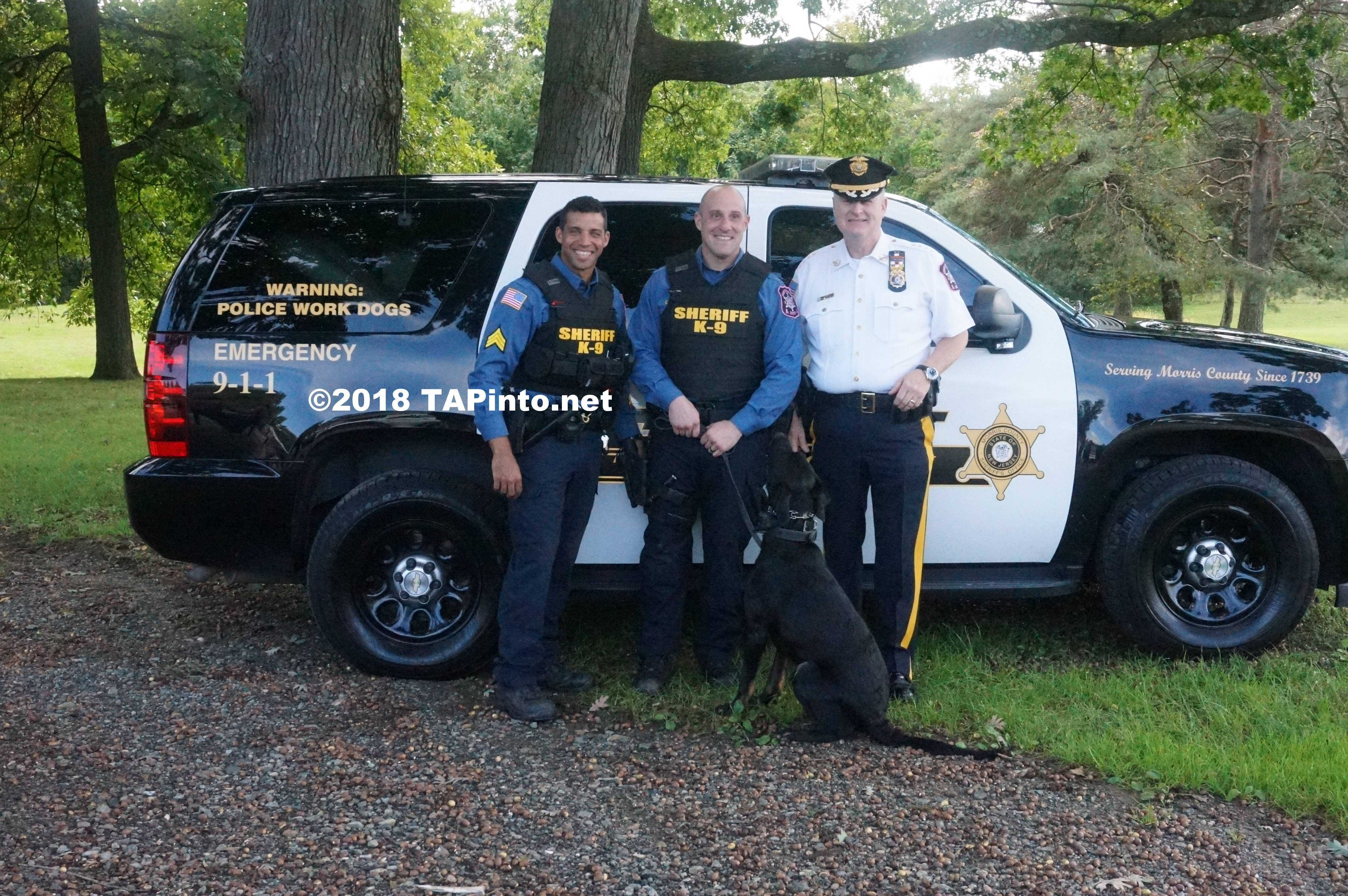 a Det. Sgt. Aaron Tomasini, Det. Michael Carbone, and Sheriff James Gannon with Boomer ©2018 TAPinto Montville     2.JPG