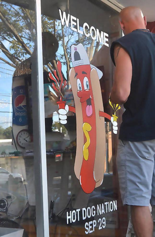 Adam hot dog nation cartoon.png