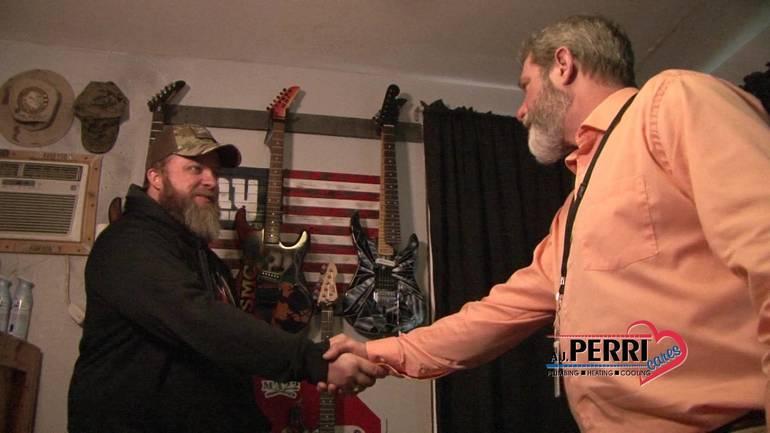 Addesso & Greg Johnston handshake.jpg