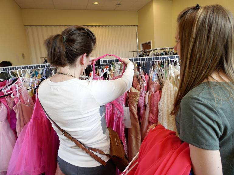 A Mother selects a gown with her teenage daughter.JPG