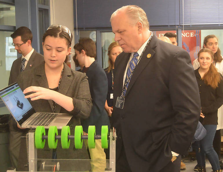 Anya Nordstrom demonstrates robot design to Sen. Sweeney.png