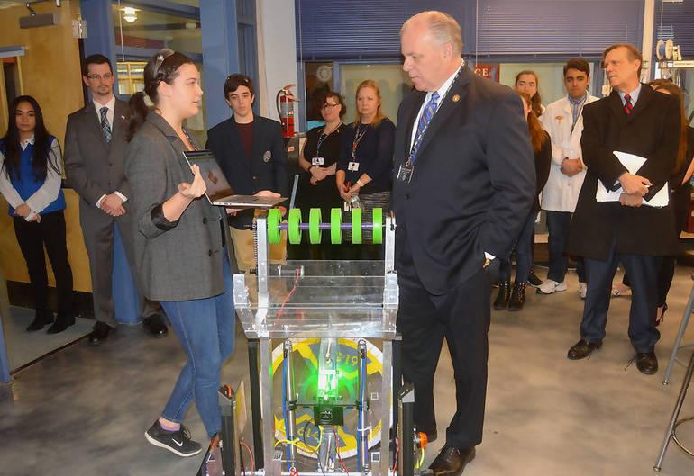 Anya Nordstrom demonstrates robot to Sen. Sweeney.png
