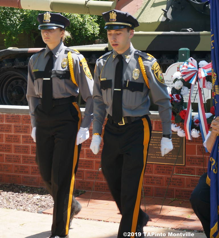 a Police Explorers Alex Benno and Pam Danko after laying a wreath to the front ©2019 TAPinto Montville.JPG