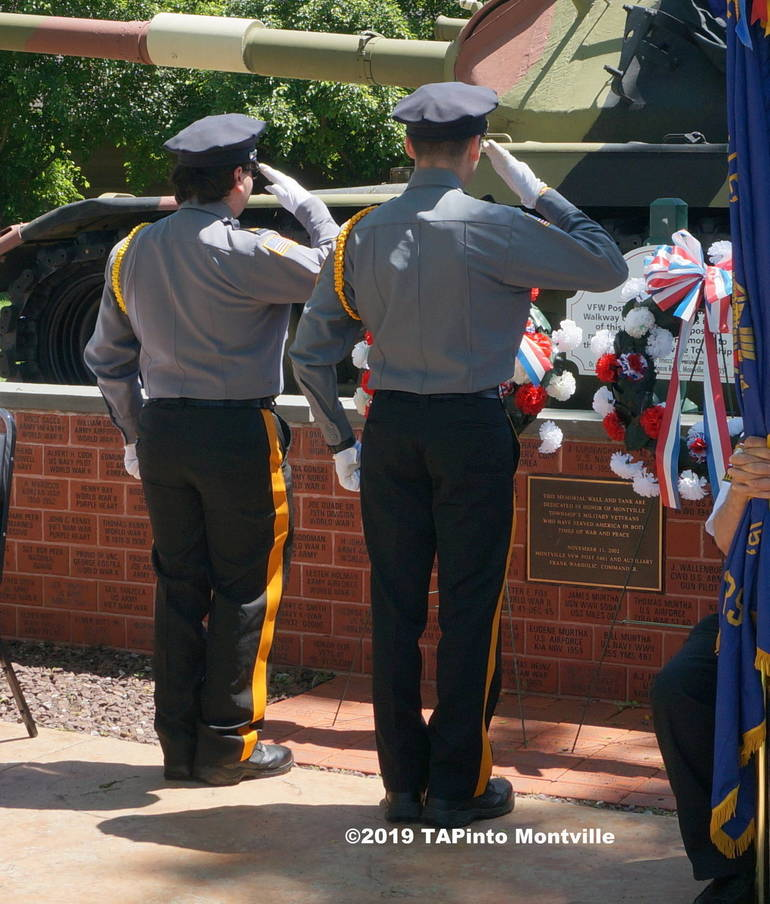 a Police Explorers Joseph Cirkus and Alex Benno  after laying a wreath at the front ©2019 TAPinto Montville.JPG