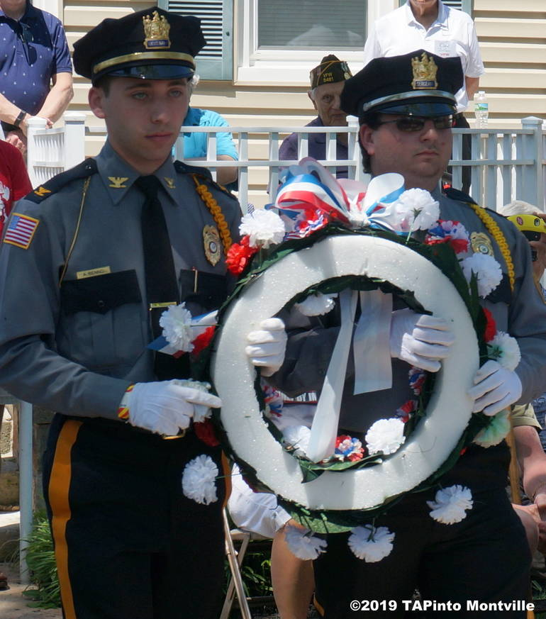a Police Explorers Alex Benno and Joseph Cirkusafter lay a wreath ©2019 TAPinto Montville.JPG