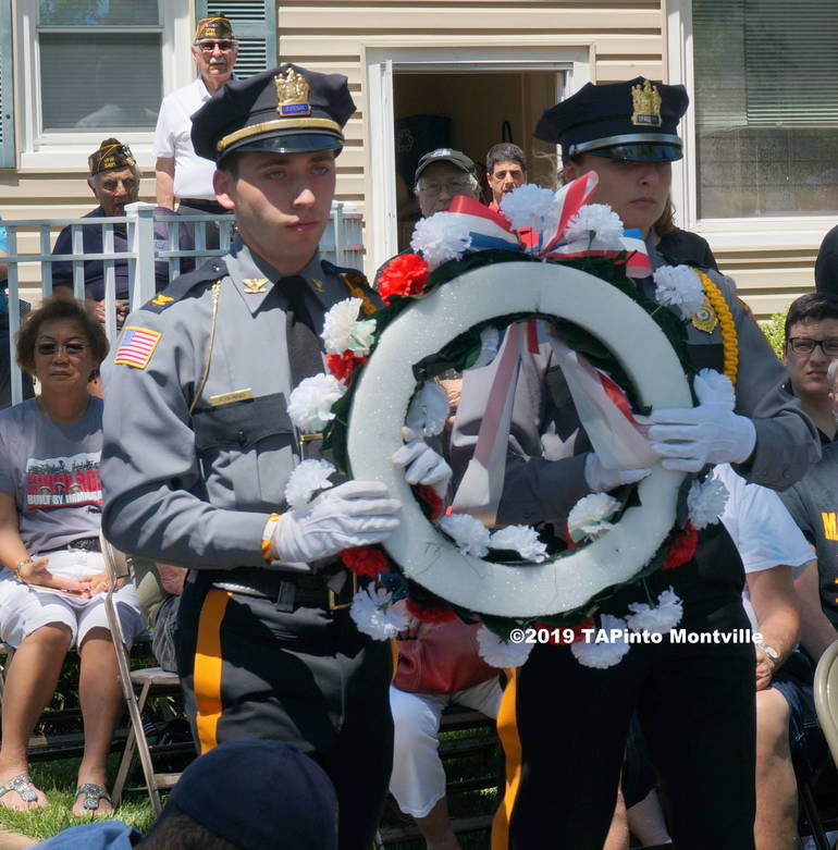 a Police Explorers Alex Benno and Pam Danko bring a wreath to the front ©2019 TAPinto Montville.JPG