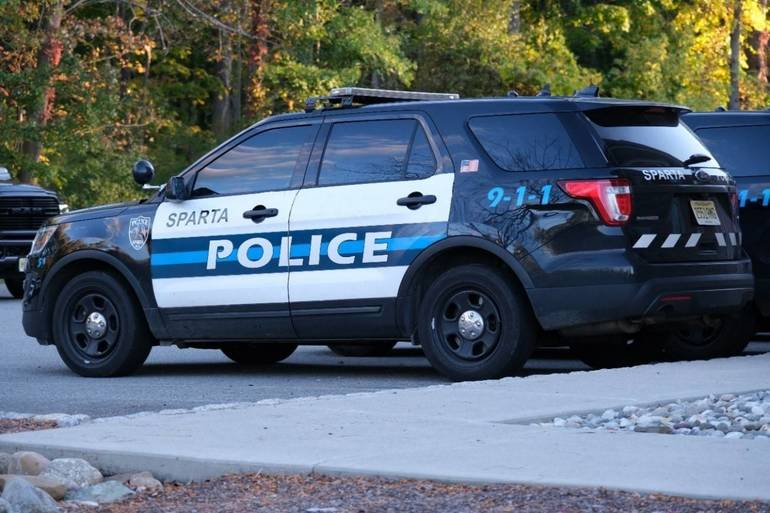 A police car in the parking lot of the SPD, carrying the 911 call number.  October 3, 2020.  Daniel Devine..jpg