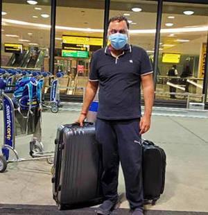 Ashu Mahajan returns home via Newark Liberty Airport.