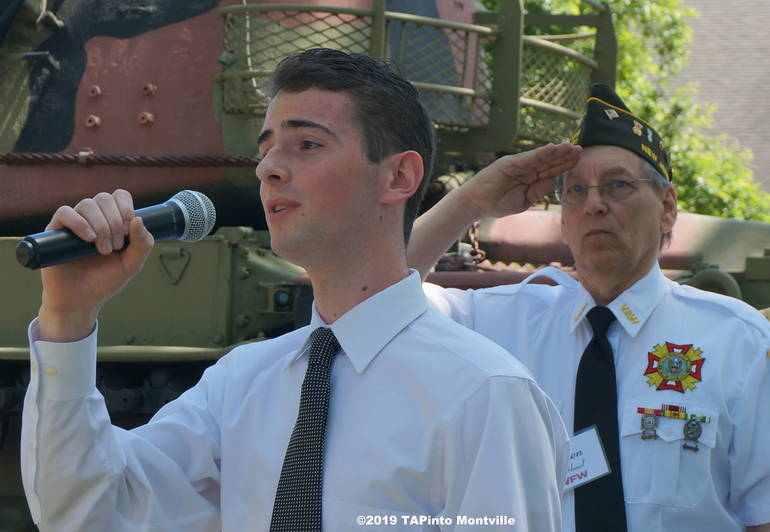 a VFW Post 5481 Commander Elect Ken Hanzl salutes as Jeffrey Gallup sings the National Anthem ©2019 TAPinto Montville.JPG