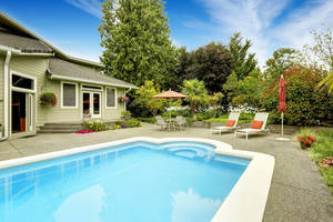 Backyard with swimming pool and patio area.Real estate in Federal Way, WA
