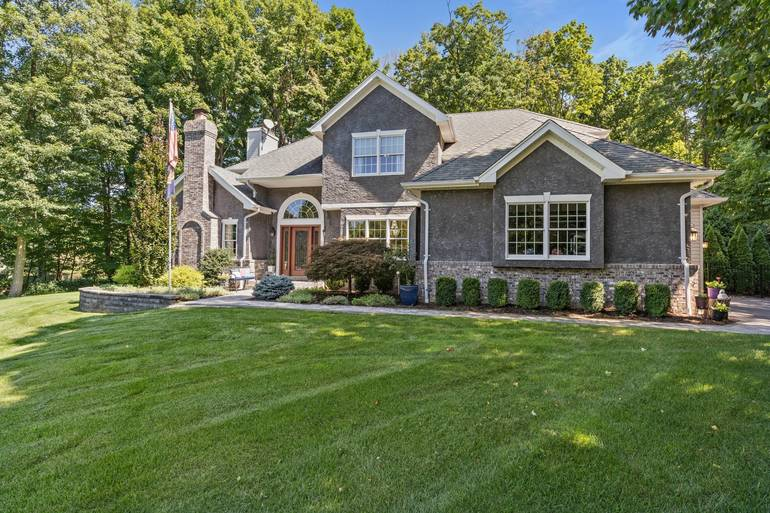 Best Front Exterior From Driveway.jpg