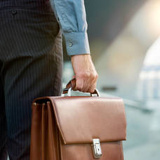 businessman with briefcase going to work