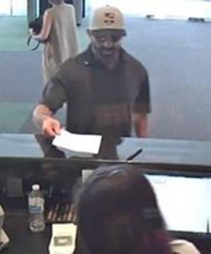 Suspect at Large after Bank Robbery in Warren, Police Seek Public's Assistance