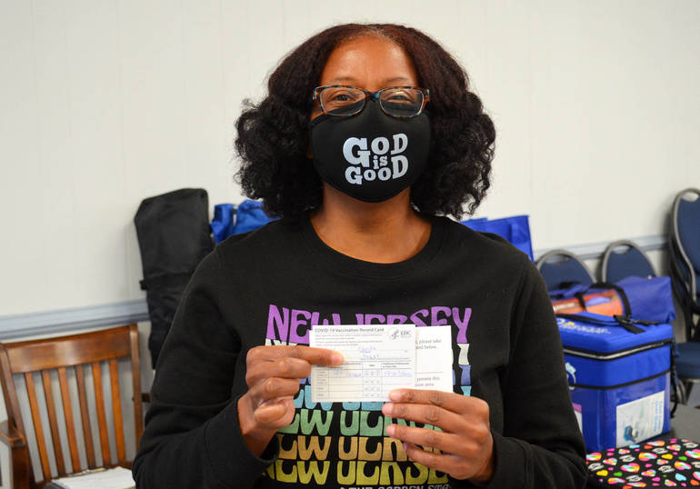 Carita Wallace shows her vaccination card