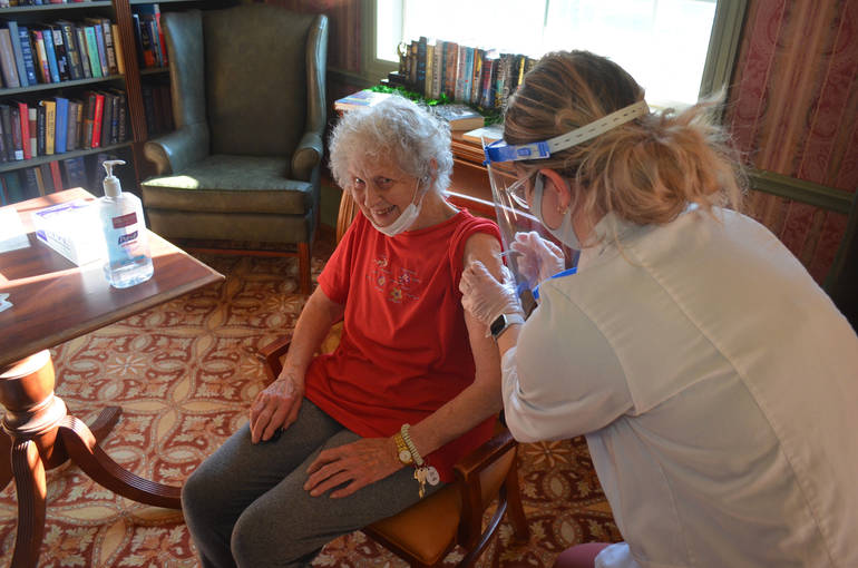 Eileen Marino, 92, a Chelsea Senior Living resident in Fanwood, receives the COVID-19 vaccine on Thursday, Jan. 7, 2021.